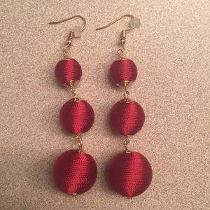 Red threaded ball earrings